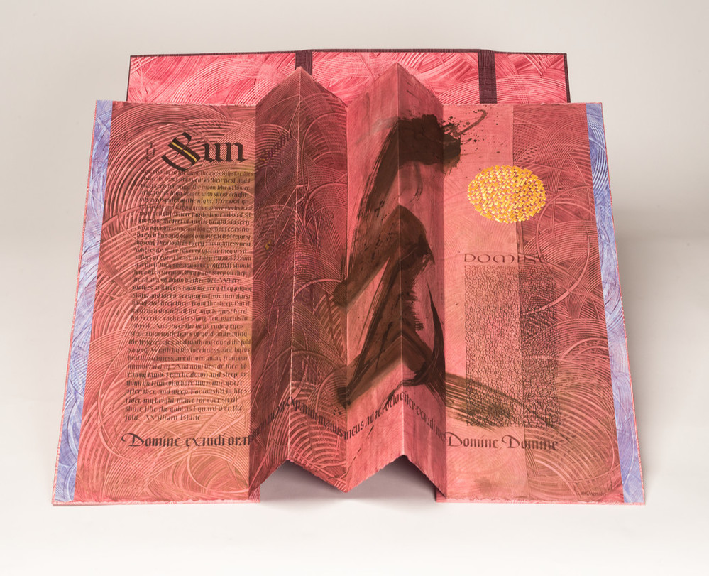 An open, accordion-style book with red-pink pages and black text. The word