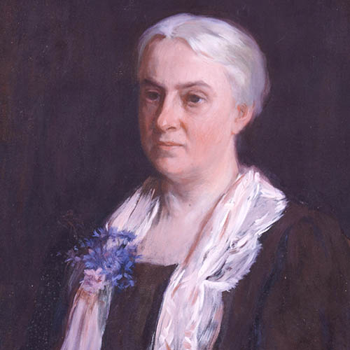 A painted portrait of a light-skinned older woman with white hair pulled back from her face. She is portrayed from the waist up against a dark background. She wears a black dress with a white sash. A bouquet of blue flowers decorates the left side of the sash. She gazes left of the frame.