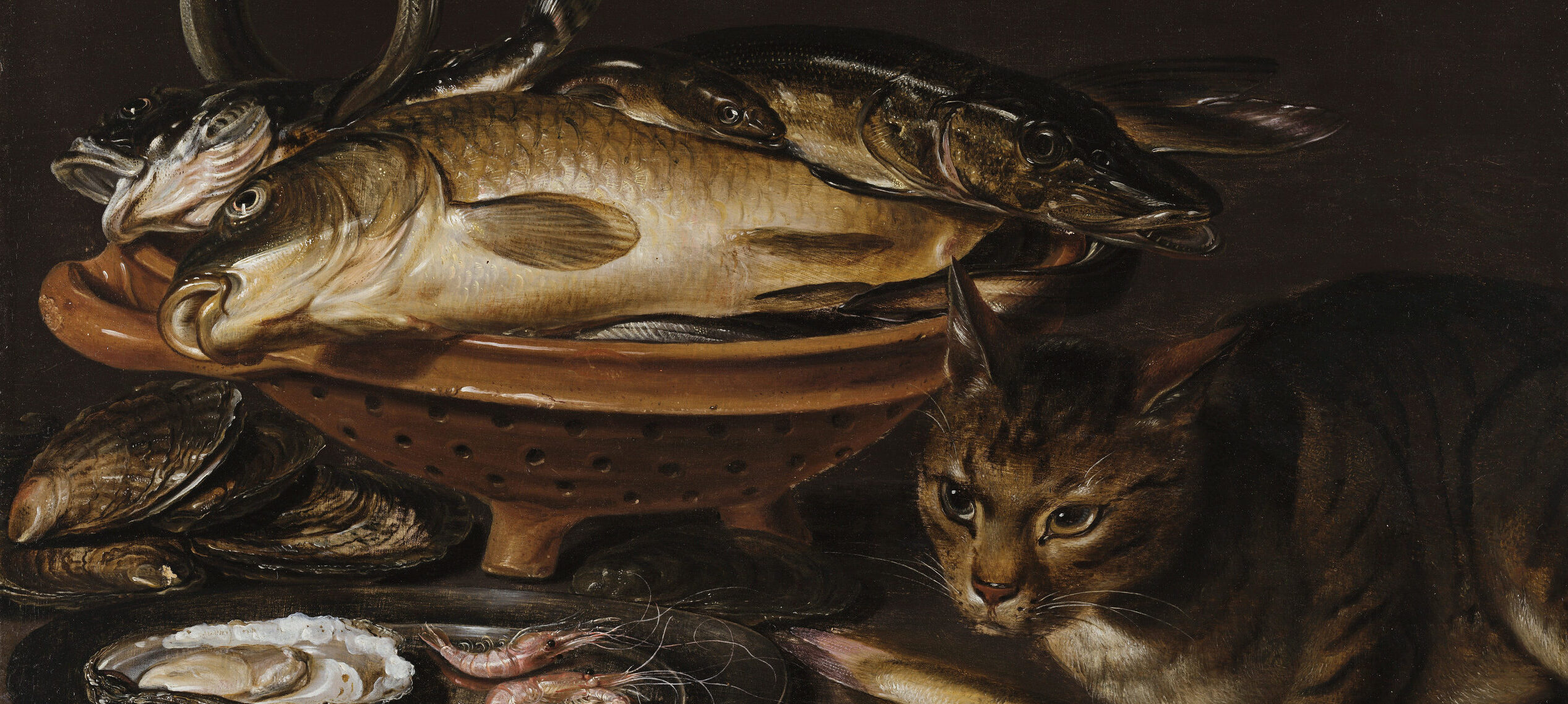 A still life painting featuring a bowl of dead fish, silver platter with an oyster and shrimp, and a cat with a fish in its paws sitting next to it.