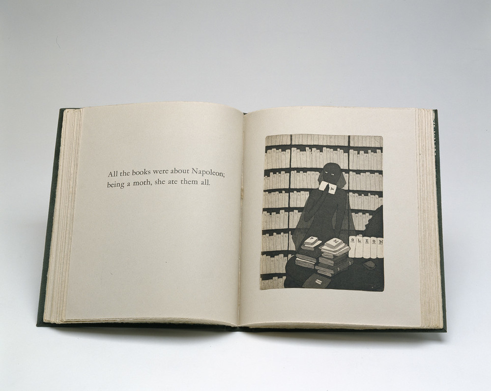 Book opened to a print illustration depicting a shadowy female figure sitting in front of bookcases. Seated at a table full of books, she holds a piece of paper to her mouth. The opposing page reads,