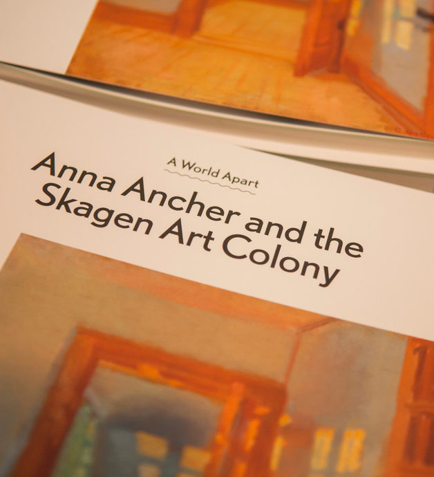 Close up shot of a brochure created for the exhibition with the name of the exhibition.