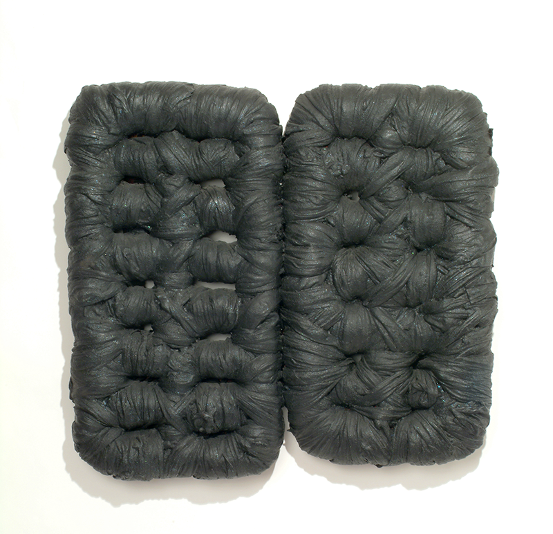 Two wooden armatures that are tightly wrapped with cloth and then coated with acrylic paint, latex rubber, and other materials. The end result resembles black mattress or raft forms.