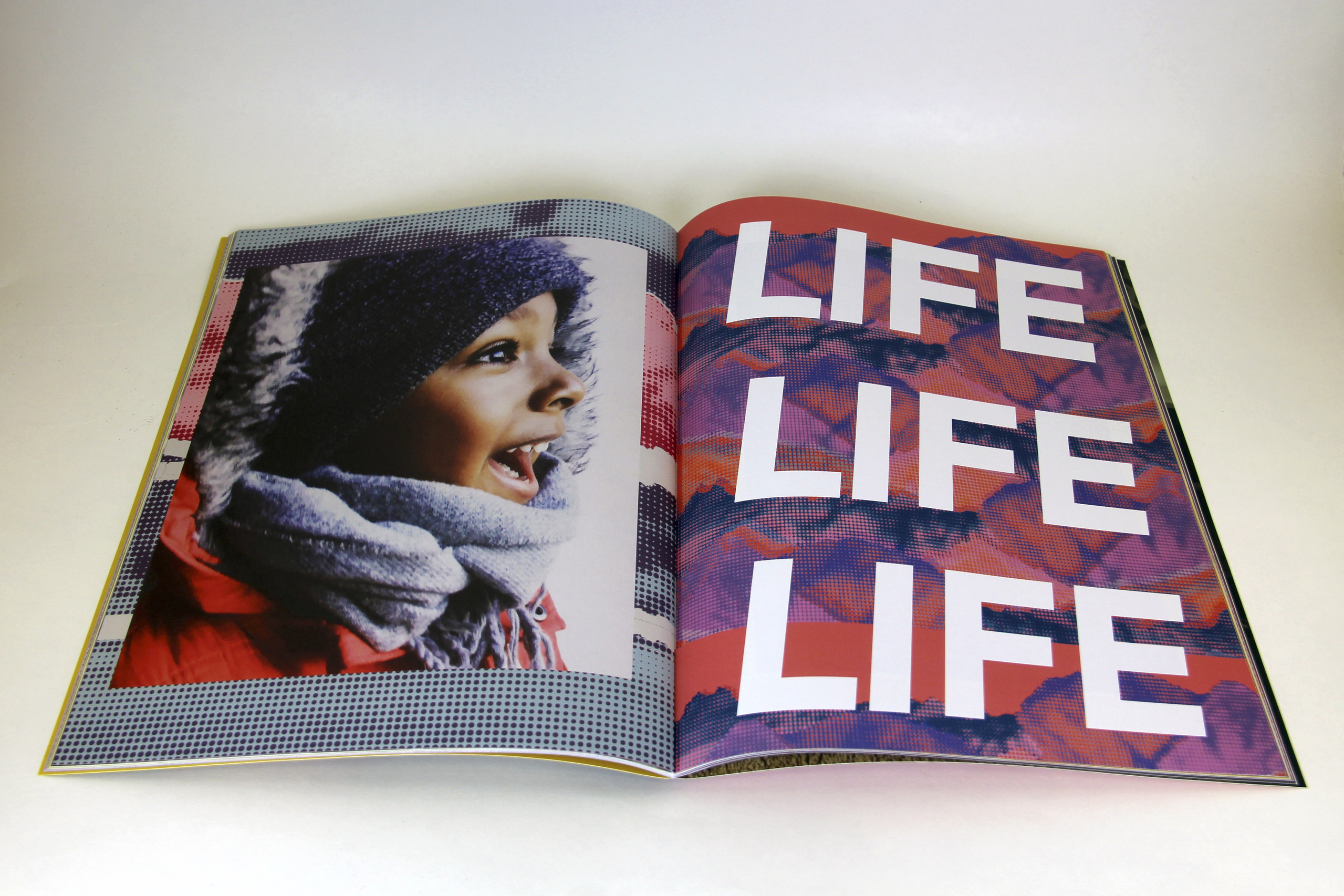 Open book features photograph of a child with medium-brown skin on the left side of the fold and the words