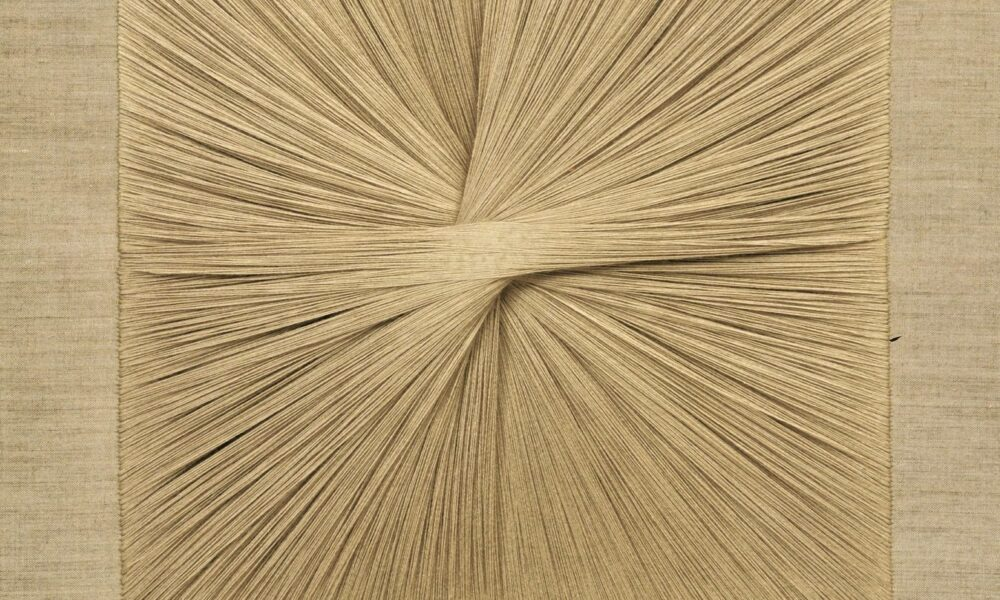 Square textile panel uses beige thread to create a starburst pattern as the central focus.