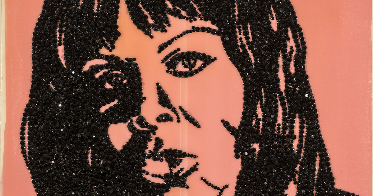An enamel painting of the face of a women in outline, made on a pink background with her features detailed in black rhinestones.