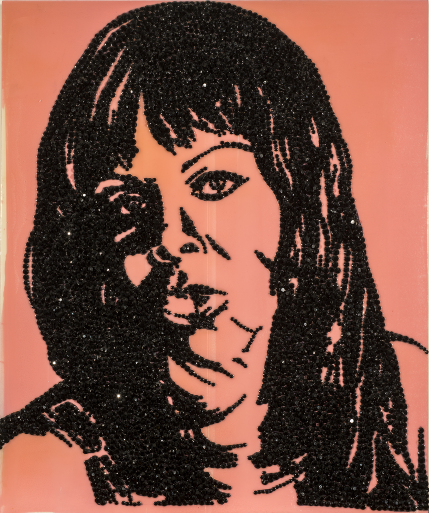 An enamel portrait painting of a woman made with encrusted black rhinestones glued to shiny pink acrylic background.