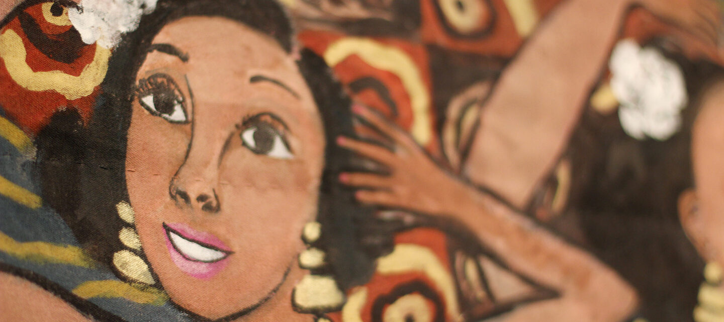 Close-up photograph of a painted quilt shows a medium-dark skinned woman dancing exuberantly. There is a white flower in her hair, and she wears dangling gold earrings and gold loops around her neck.