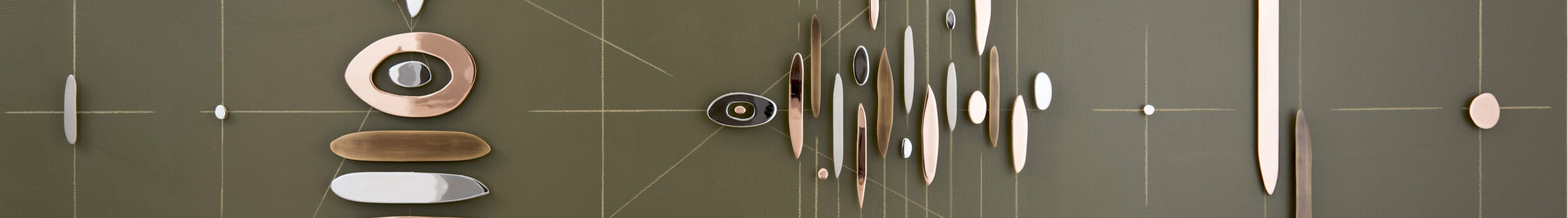 Abstract wall sculpture featuring horizontal, vertical, and diagonal intersecting lines overlaid with pieces of rounded, plated steel