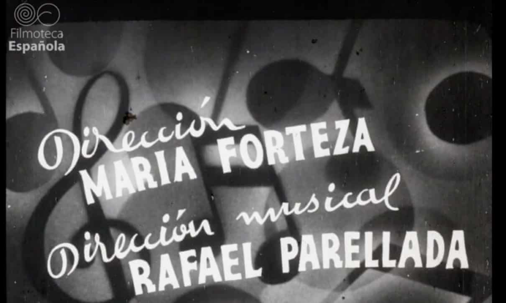 """A black-and-white film still. In the center, slightly askew, the name """"Maria Forteza"""" is written in bold capital letters. The title """"Dirección"""" is written in script above her name. Large music notes and symbols comprise the background, and the screen is marked by dust and blemishes."""
