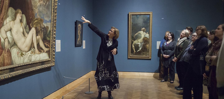 Kaywin Feldman discusses a painting at the Minneapolis Institute of Arts; Photo credit: Minneapolis Institute of Art