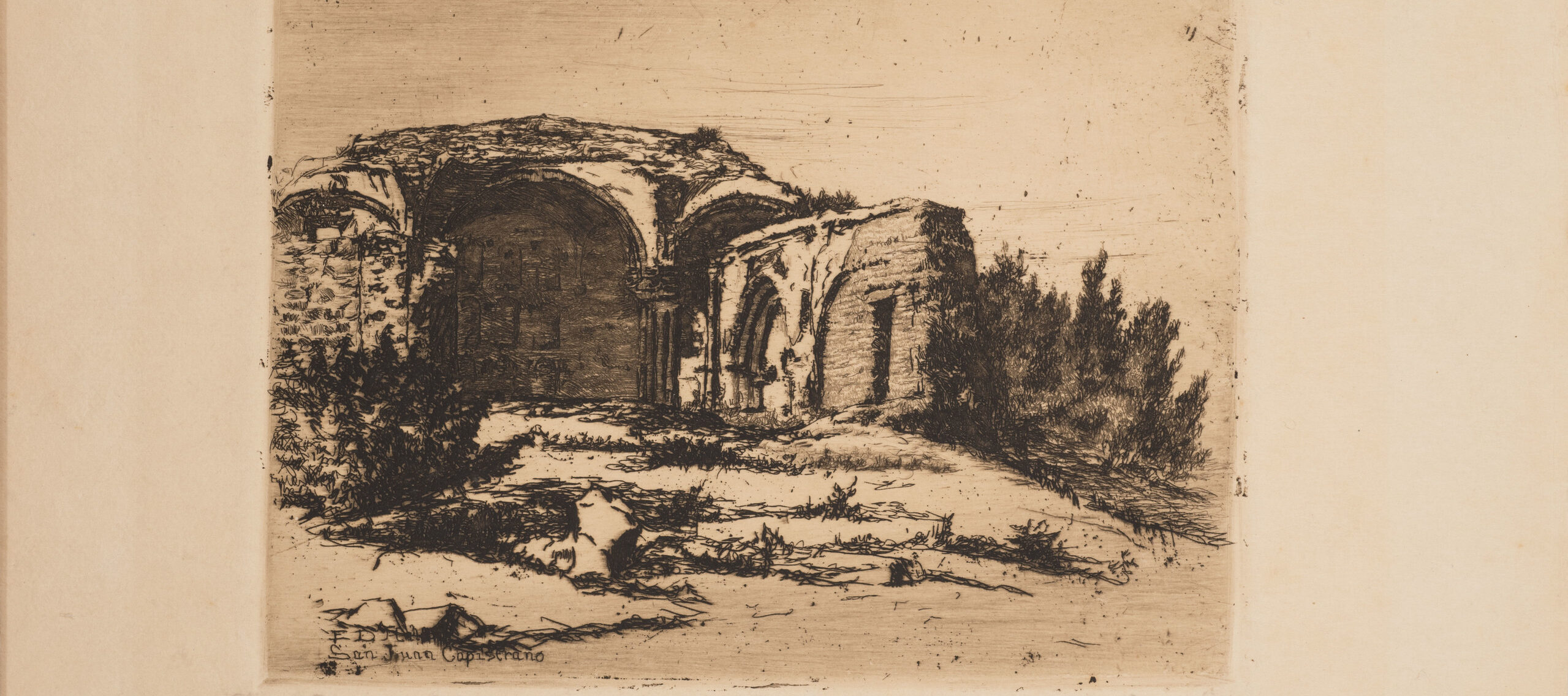 Small print of black ink on ecru paper depicting the ruins of an old Catholic mission building. The building, featuring rounded arches, crumbling facades, and exposed brick, is surrounded by scrub bushes and desert landscape.