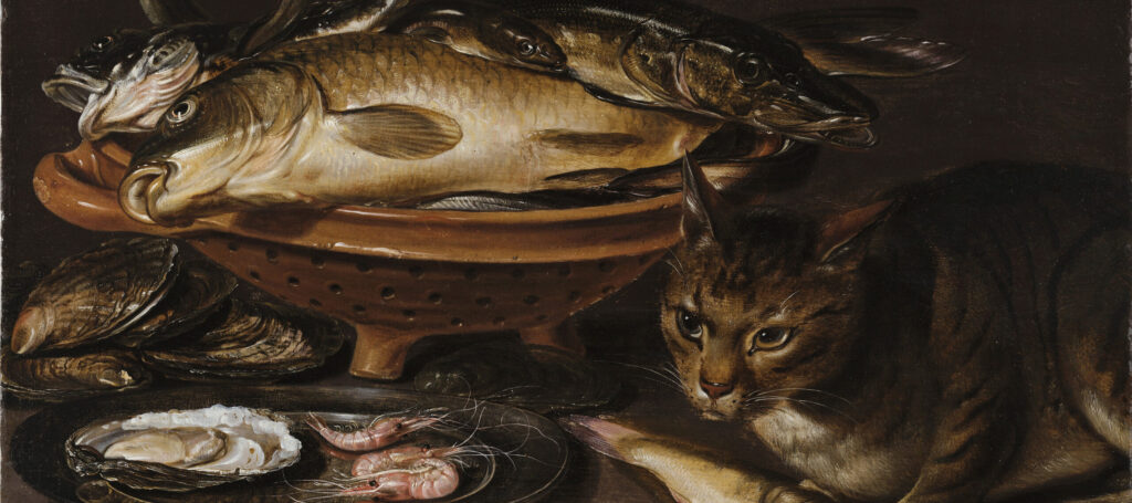 Still life painting features a reddish ceramic colander with several types of fish. In the foreground, a cat stands alert next to shrimp and oyster shells on a gleaming pewter dish.