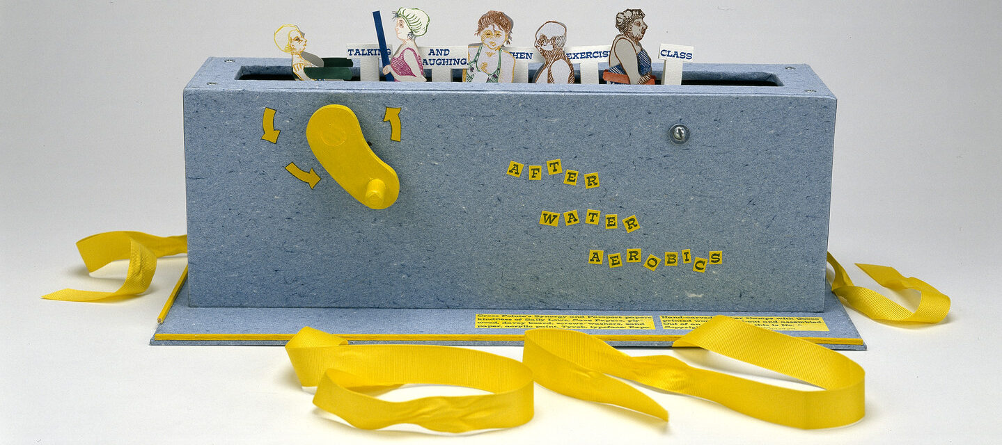 """Paper figures in swimwear emerge from a grey-blue box with a slot in the top, like a toaster, and a yellow crank on the side. Small signs say """"talking"""" """"and laughing"""" """"exercise"""" """"class."""" Yellow ribbons, untied, are at the base of the box."""