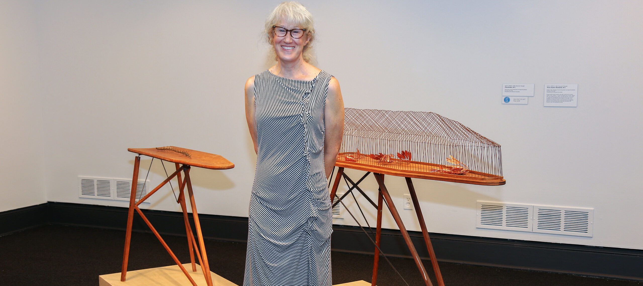 Holly Laws with her works in <i>Heavy Metal</i>; Photo: Sarah Baker