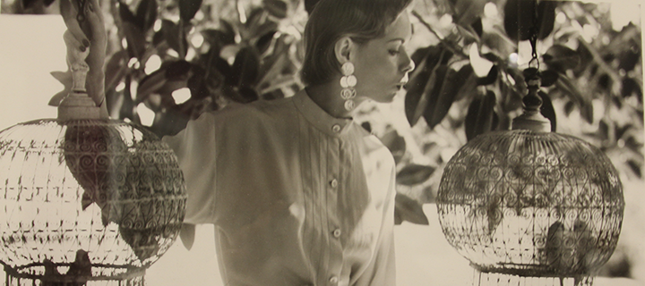 Louise Dahl-Wolfe, <i>Natalie with Birdcages</i>, 1950; Gelatin silver print 14 x 11 in.; National Museum of Women in the Arts, Gift of Helen Cumming Ziegler