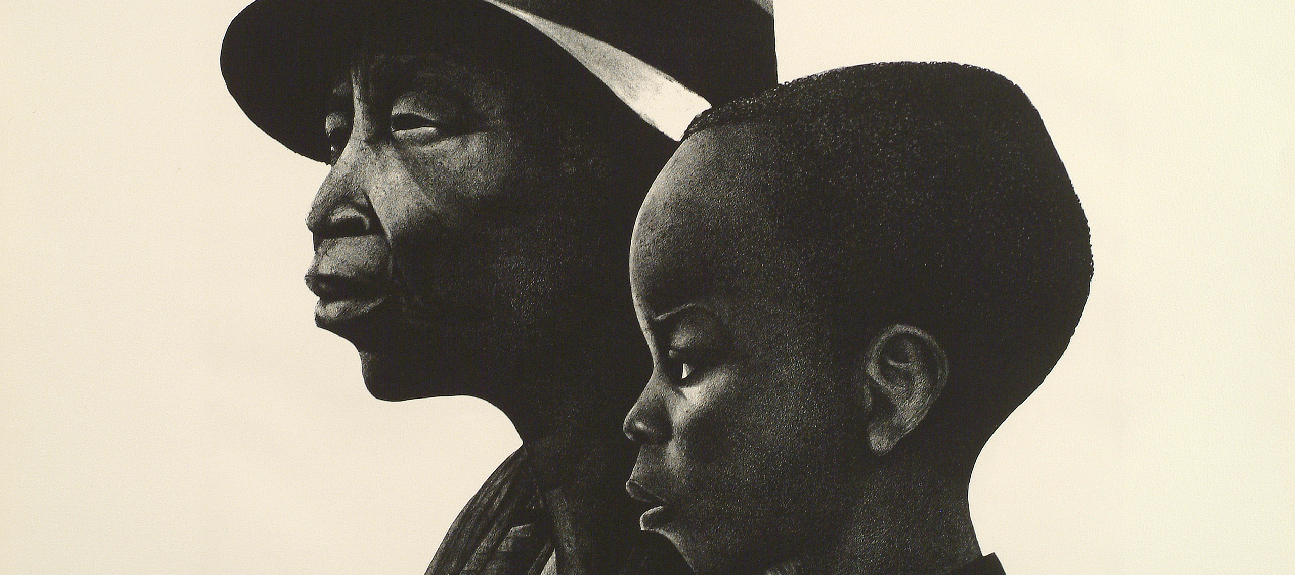 Black and white print of two dark-skinned individuals in profile. The person in the background is an older adult wearing a brimmed hat, and in the foreground and slightly to the right is a young child in profile.
