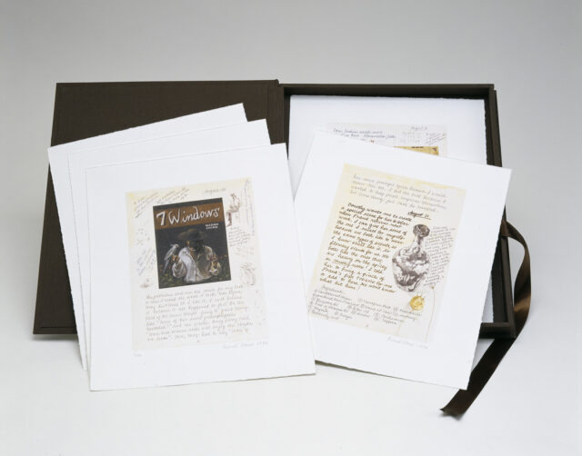 A black portfolio of prints is open, revealing its contents. Three stacked prints are on the left with only the top one visible. To the right, two prints are seen, only the top one completely.