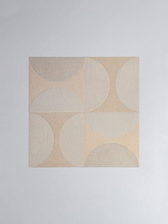 On a white background, a beige square is divided into quadrants. Each quadrant has two semi-circles, the rounded edges facing each other. The surface of the paint is marked by miniscule shallow raised cuts into the top layer of the paper.