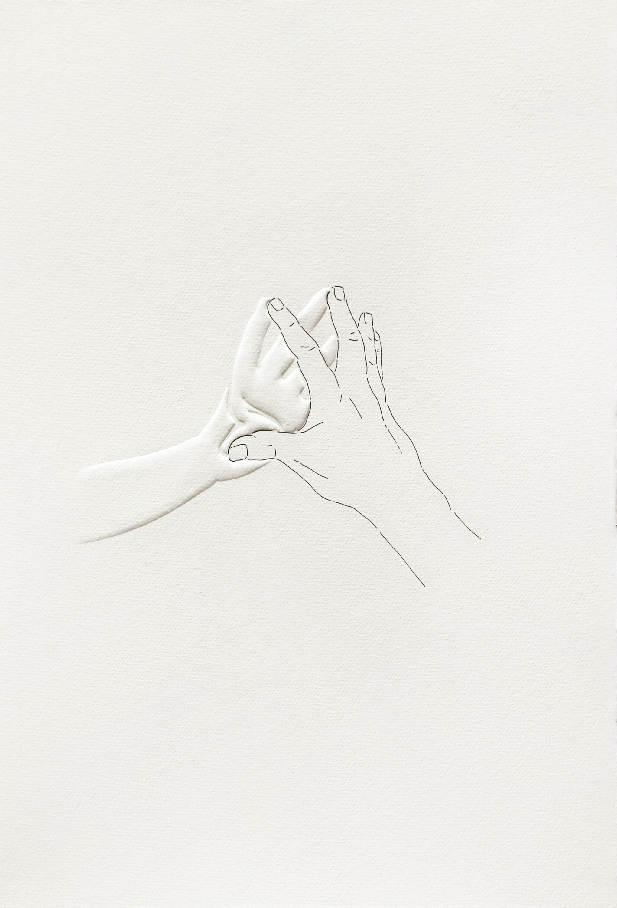 An image of two hands touching by their fingertips. The back of one hand is drawn on the paper and the palm of the other is embossed.