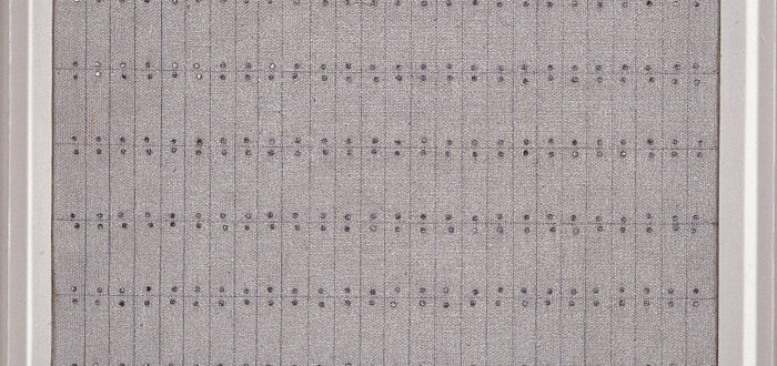 Painting with nine by twenty-six grids formed by pencil on a textured, gray background. Tiny silver nail heads hug the top and bottom of each section. Exact in design, the effect is one of imperfection as the lines are not perfectly straight and the nails do not totally line up.