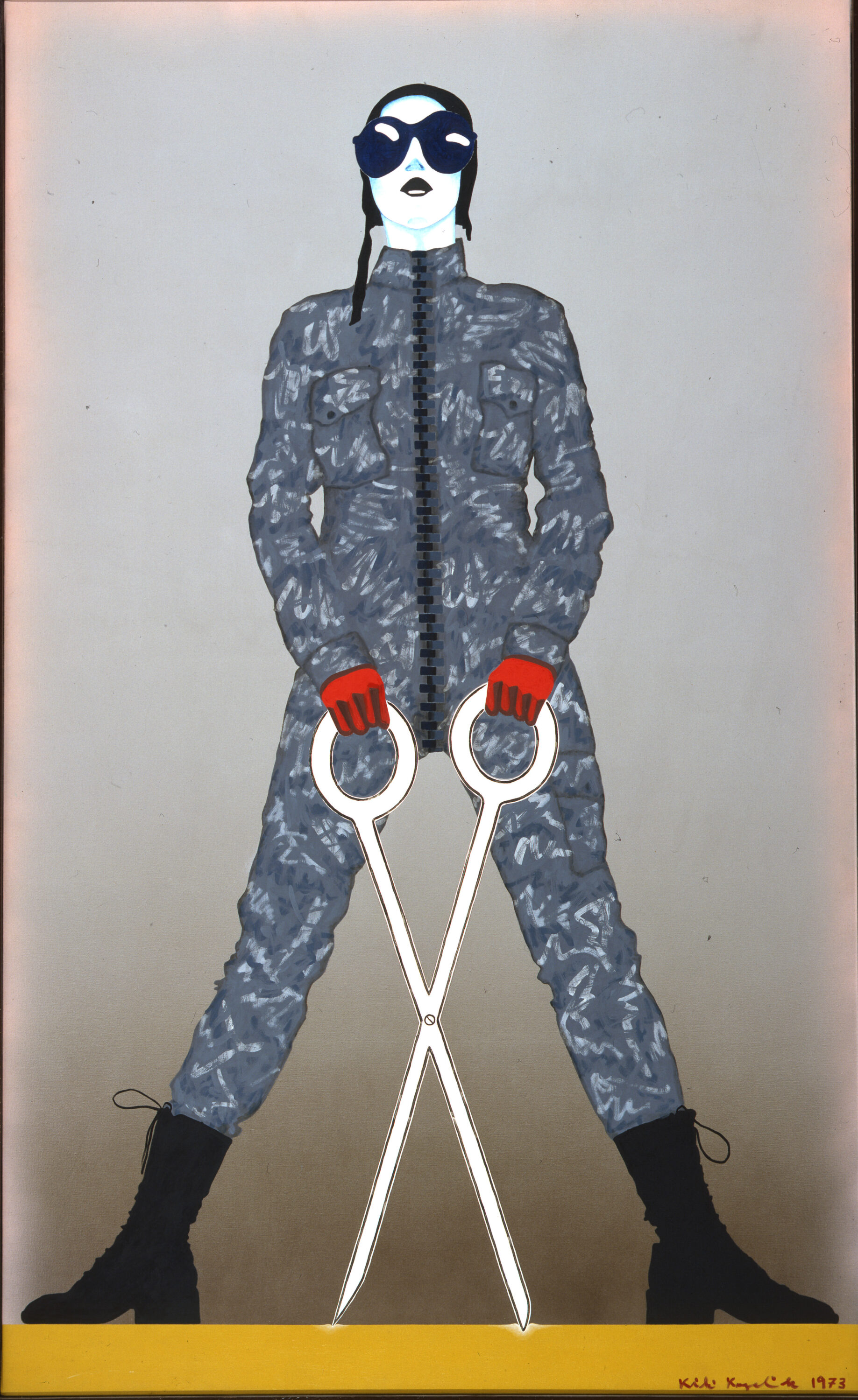 A monumental figure sports a gray camouflage jumpsuit, black army boots, red gloves, and an aviator cap with goggles. Legs splayed, the standing figure wields oversized, white scissors open in an X-shape. The linear style, bulbous eyewear, and cartoonish weapon evoke comic books.