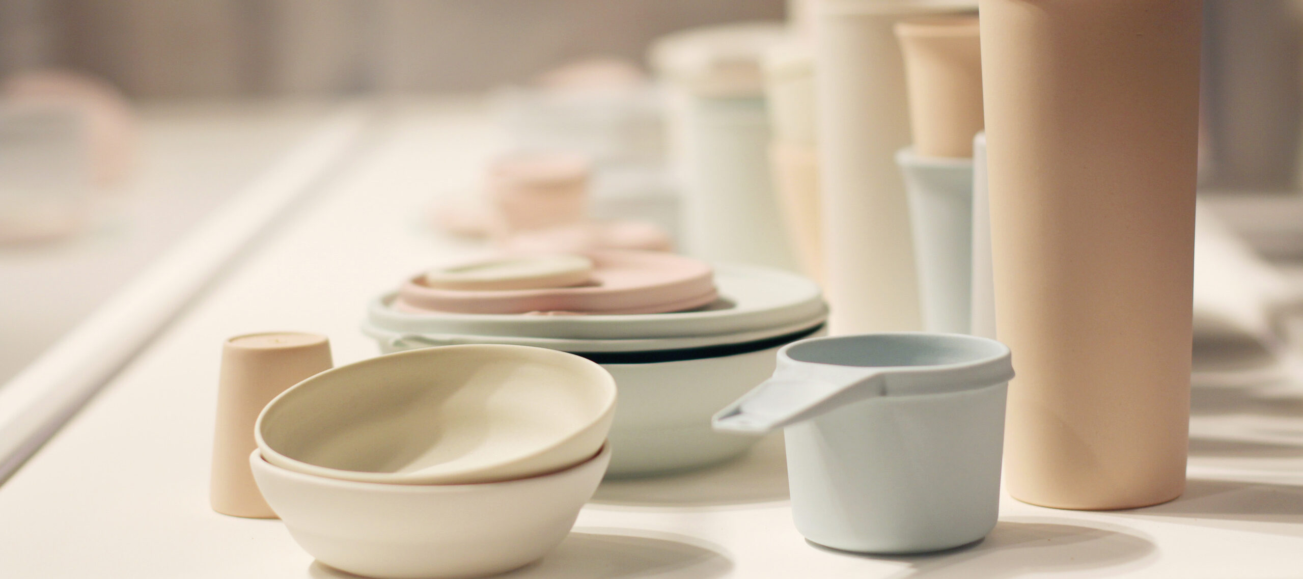A large collection of pastel, ceramic vessels resembling stacks of myriad Tupperware.