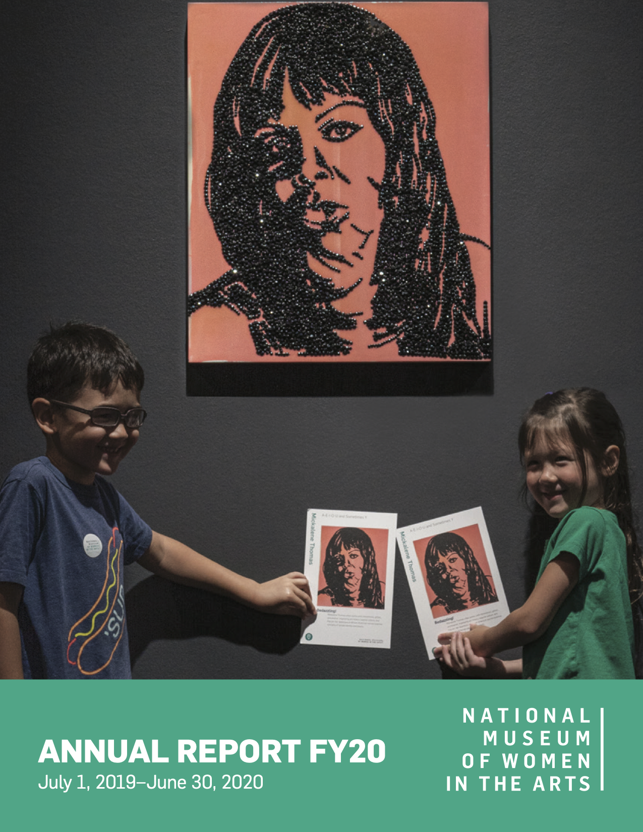 Annual report cover with an image of two children in the gallery holding up postcards with reproductions of the mixed media artwork hanging on the wall behind them.