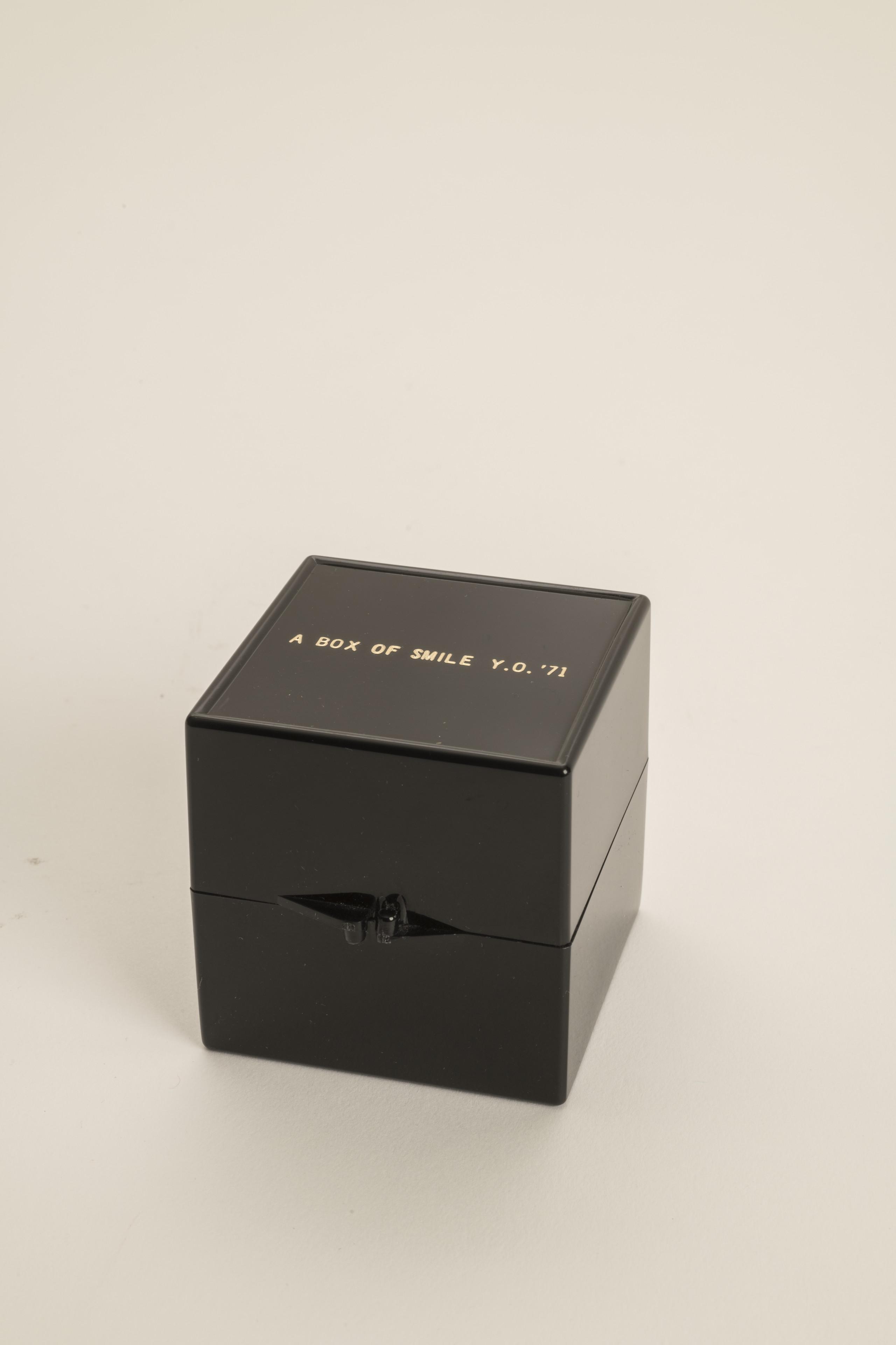 A small black square box that has