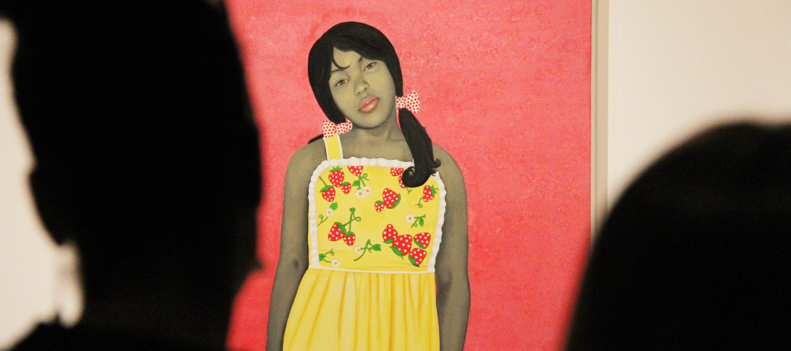 Vibrant painting of a young lady with medium skin tone staring out against a bright pink background. The painting is partially obscured by the silhouetted heads of museum visitors.