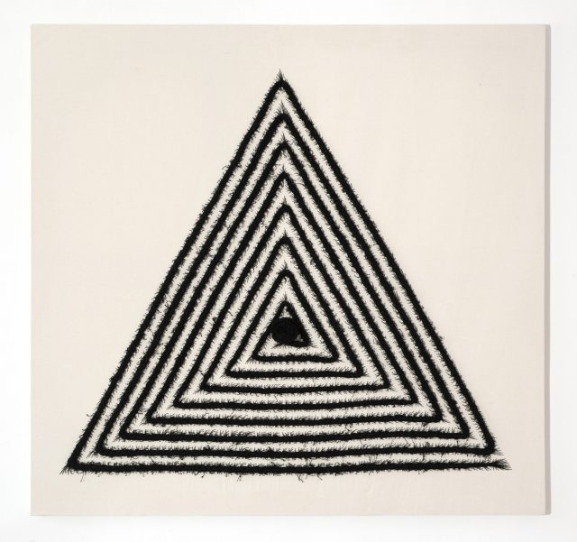 An off-white, square canvas with a large equilateral triangle in the center made from stitched black cotton thread. The thread has been braided, as a cornrow, in a triangular spiraling patter than ends with a large knot in the center of the triangle.