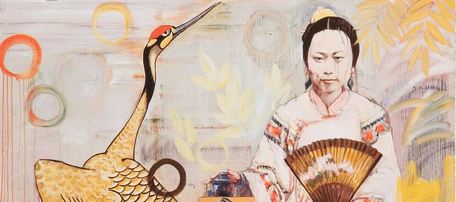 A painting of a light skinned Chinese woman with dark brown hair sitting cross-legged on a stool gazing out at the viewer. The woman wears a light pink robe with coral flowers on the sleeves. She holds a gold fan with light pink flowers. Her hand rests on a square object with a rounded lid. On the left side of the painting a white and black crane with a red crown lifts its head to the sky.
