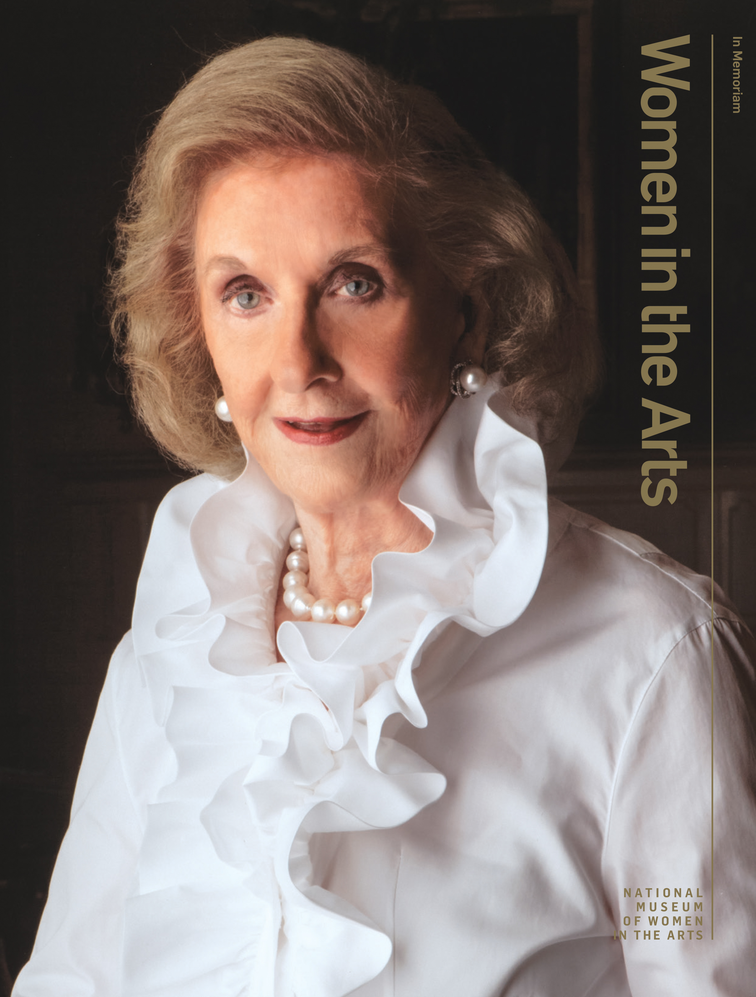 Cover of 'Women in the Arts' magazine featuring a professional portrait of Wilhelmina Cole Holladay. She is a light-skinned, older woman with a blonde bob. She wears an elegant white ruffled blouse and pearl jewelry.