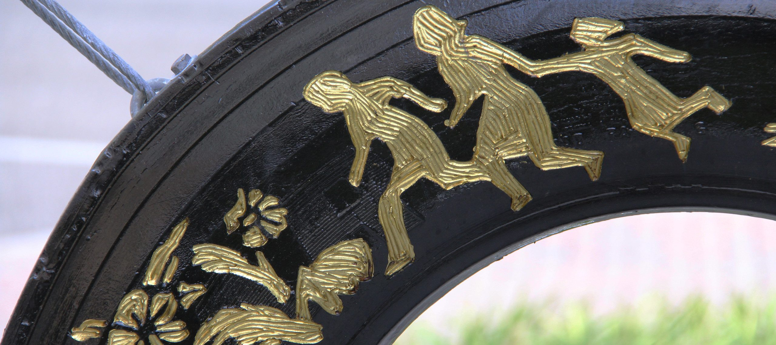 Betsabeé Romero, <i>Huellas y cicatricez (Traces and scars)</i> (detail), 2018; Four tires with engraving and gold leaf and steel support, approx. 192 1/2 x 86 5/8 x 9 3/4 in.; Courtesy Betsabeé Romero Art Studio; Photo by Mara Kurlandsky, NMWA
