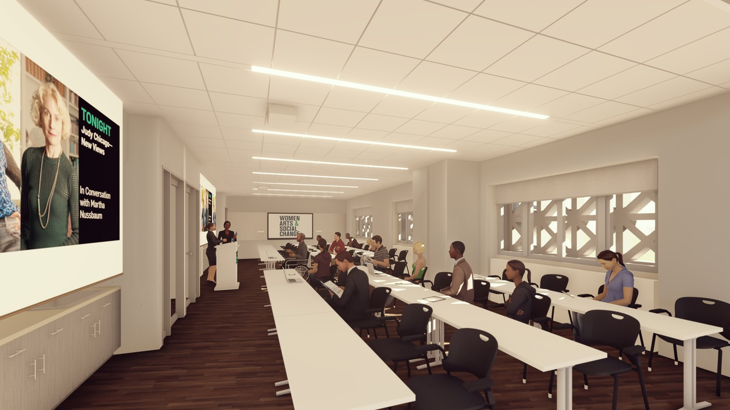 Rendering of the education studio with three rows of long tables and people sitting in lecture-style seating.