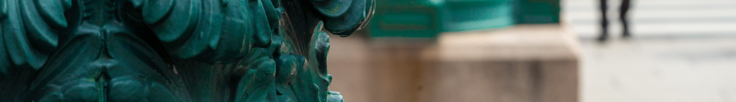 Detail of a photograph of a green post outside of the museum's exterior.