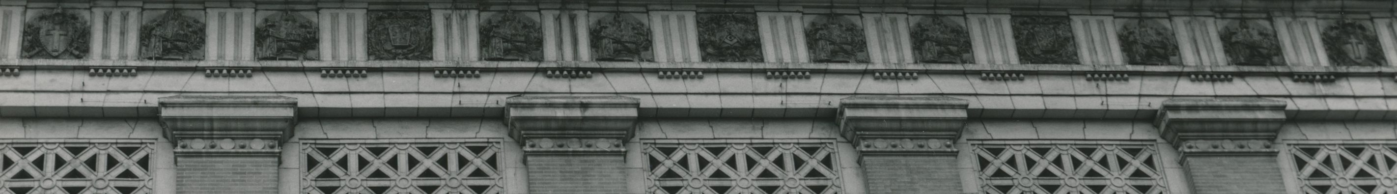 Black and white photograph of the museum exterior with a view of the upper half of the facade.