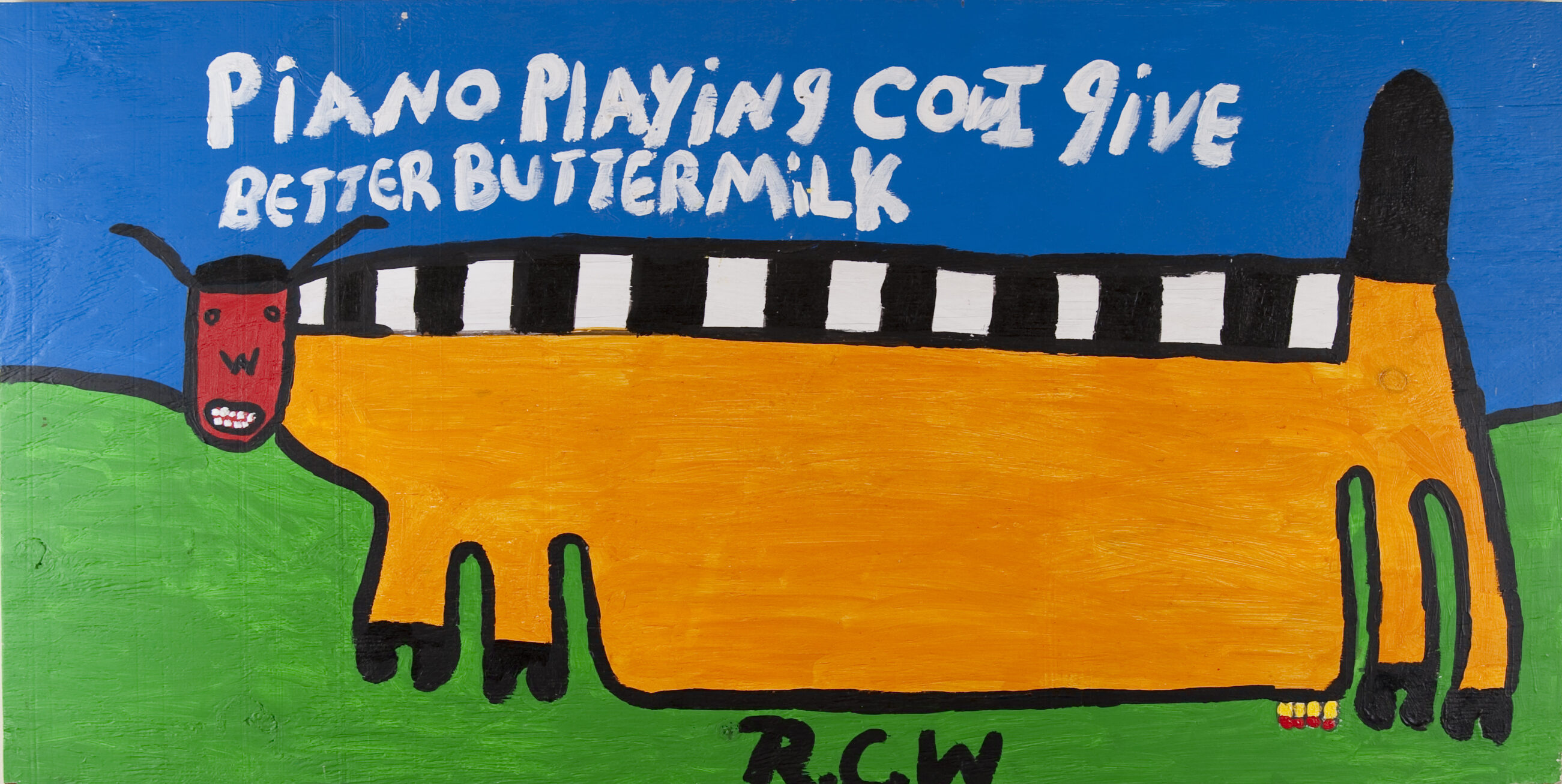 A four-legged, cow-like, rectangular creature stands on a green field, above the initials R.C.W. It has a black and white striped back, golden body, black tail, red humanoid face, black hooves, and udder. It is under a blue sky and the white words 'piano playing cow I give better buttermilk.'