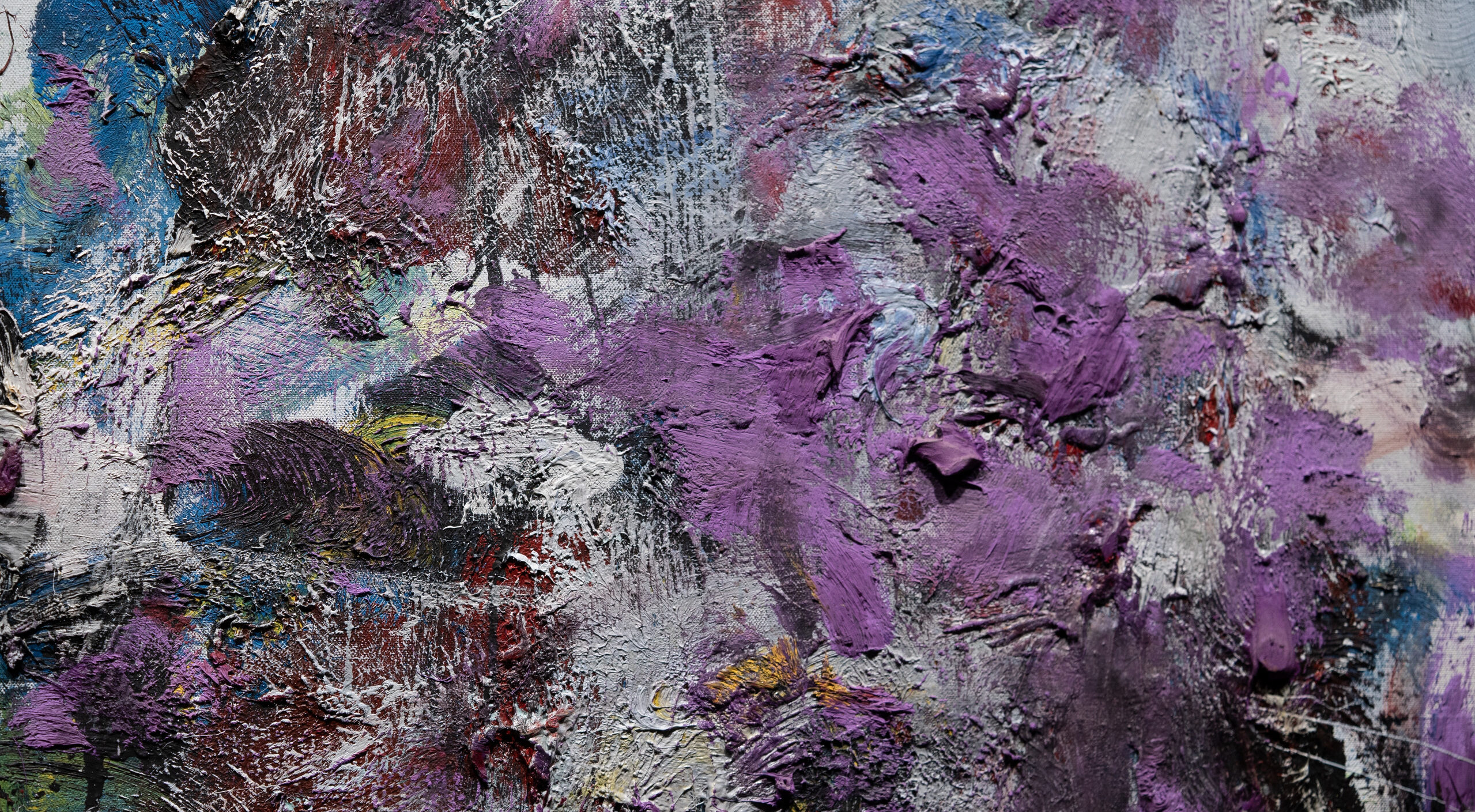 Close-up detail of an abstract painting that features dense and chaotic brushstrokes of pale gray, lavender, and cobalt.