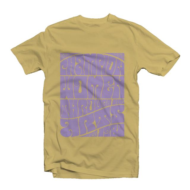 """Daffodil-colored t-shirt features NMWA's slogan, """"Champion Women through the Arts,"""" in lavendar psychedelic lettering."""