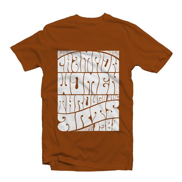 """Rust-colored t-shirt features NMWA's slogan, """"Champion Women through the Arts,"""" in white psychedelic lettering."""