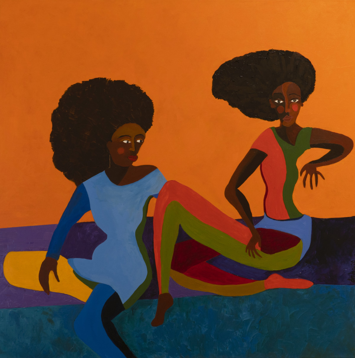 A colorful figurative painting features two dark-skinned women sitting in a relaxed manner atop a blue and purple floor. They both have large afros and wear color-blocked outfits: the woman on the left a blue and green dress, and the woman on the right a peach and green shirt and pant set. The painting's background is a bright orange.